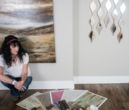 Brenda Macaluso with Macaluso Custom Design looks over some faux painting samples that she may give to a faux painting client. Brenda is the owner of Macaluso Custom Design, 203 NE 70th Terrace, Gladstone MO  64118.