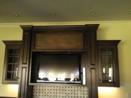 Faux Fireplace Mantle is the focal point of the room. Turn your wood or tie fireplace mantle into a look of stone  by Macaluso  Custom Design in Gladstone, MO.